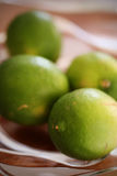 Limes in Bowl Stock Photo