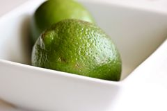 Limes in Bowl Stock Photography