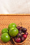 Limes and cherries Stock Photo