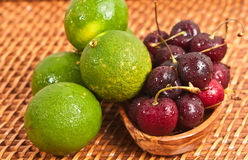 Limes and cherries Royalty Free Stock Photo