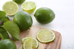 Limes on chopping board. Stock Image