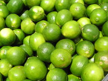 Limes Closeup. Shot into a crate of limes at a farmers' market Stock Photos