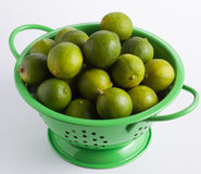 Limes in colander 3 Stock Photography