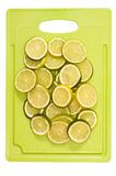 Limes on a cutting board. Isolated Royalty Free Stock Photos