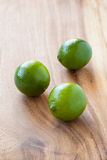 Limes on cutting board Royalty Free Stock Photography
