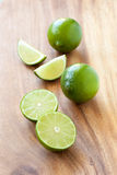 Limes on cutting board Stock Photo