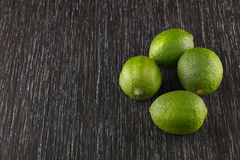 Limes on dark background Stock Image