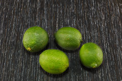 Limes on dark background Royalty Free Stock Image