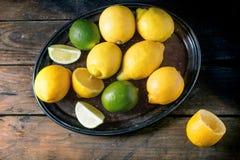 Limões e cais Foto de Stock Royalty Free