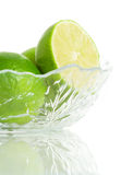 Limes in a Glass Dish Royalty Free Stock Photo