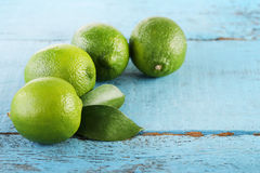 Limes with green leaf Stock Image