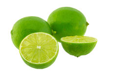Limes with half isolated Stock Images