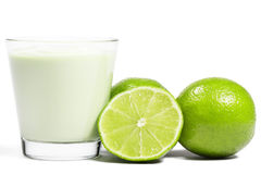 Limes and a half near milkshake Royalty Free Stock Image