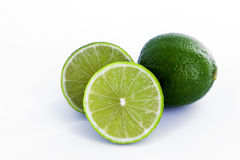 Limes with half  on white background Royalty Free Stock Photography
