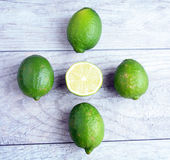 Limes half  and whole Stock Photos