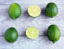 Limes half  and whole Royalty Free Stock Photos