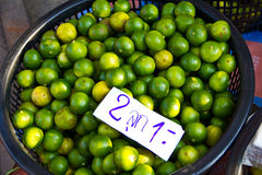 Limes In Basket At The Market Stock Photo