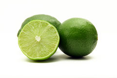 Limes isolated on white stock images
