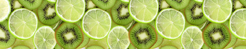Limes and kiwi fruits stock images