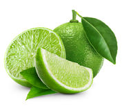 Limes with leaf. Limes  with leaf on white background Stock Photo