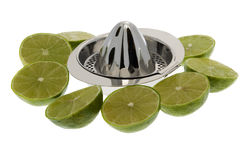 Limes with lemon squeezer Stock Images