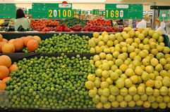 Limes and lemons. In a supermarket stock images