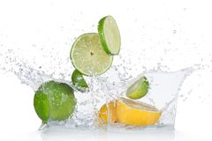 Limes and lemons with water splash Royalty Free Stock Photo