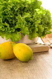 Limes and lettuce Royalty Free Stock Photos