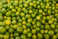 Limes at a market in Mexico. In summer Stock Image