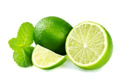 Limes with mint isolated Stock Photos