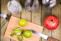 Limes ona a cutting board Royalty Free Stock Images