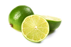 Limes. One whole limes, two half lime. Shalow DOF. Not isolated. Simply white background Stock Image