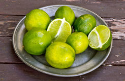 Limes On Pewter Plate. This is an image of limes on a pewter plate Stock Photos