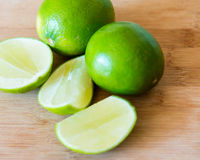 Limes: realistic approach to food ingredients Royalty Free Stock Photos