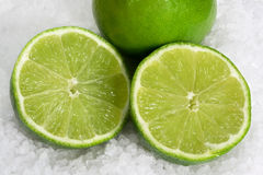 Limes on Sea Salt Royalty Free Stock Image