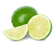 Limes with slices. Isolated on white Stock Images