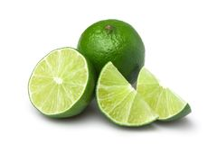 Limes with slices. Isolated on white background royalty free stock photos