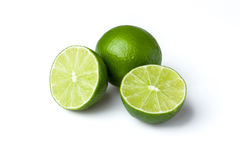 Limes with slices isolated on white background.  royalty free stock photo
