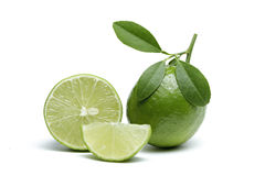 Limes with slices  isolated on white background. Royalty Free Stock Photography