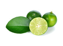 Limes with slices and leaves Royalty Free Stock Photography