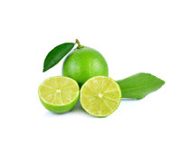 Limes with slices and leaves isolated on white background Stock Photo