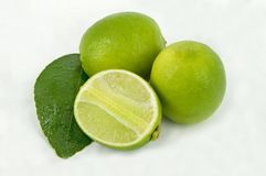 Limes with slices and leaves Stock Photos