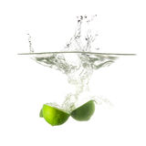 Limes splash on water, isolated on white background. Stock Photo