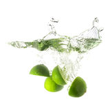 Limes splash on water, isolated on white background. Royalty Free Stock Photo