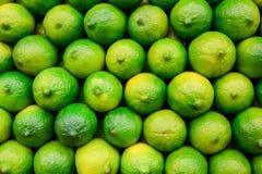 Limes. Stack of fresh limes on display Stock Photo