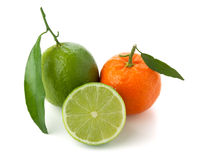 Limes and tangerine. Isolated on white background Stock Photo