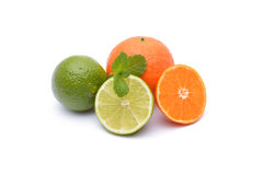 Limes and tangerines on white. Background Stock Photo