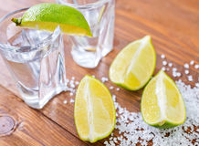 Limes and tequila Royalty Free Stock Photo