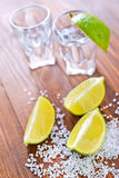 Limes and tequila Royalty Free Stock Images
