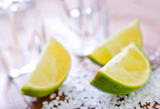 Limes and tequila Stock Images